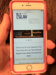 Solomita Law Teleseminar on iphone screen